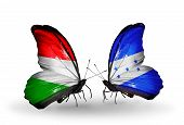 Two Butterflies With Flags On Wings As Symbol Of Relations Hungary And Honduras