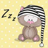 foto of sleepy  - Sleepy cat in a cap on a dots bakground - JPG