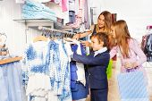 Children with their mother shopping together