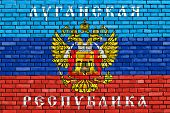 Flag Of Lugansk Peoples Republic Painted On Brick Wall