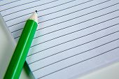 Blank notepad with pencil