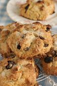 stock photo of dry fruit  - Rock Cakes light crumbly cakes filled with dried fruit - JPG