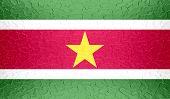 picture of suriname  - Closeup of Suriname flag on metallic metal texture - JPG