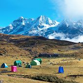 Campsite With Tents On The Top Of High Mountains