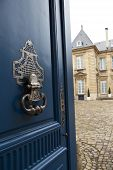 pic of mansion  - Stylish door knocker of a French mansion - JPG