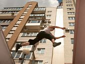 stock photo of parkour  - Teenagers are engaged in very dangerous kind of sports - JPG