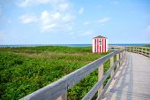 stock photo of lifeguard  - Looking down the boardwalk to the lifeguard shack at Greenwich Beach, Prince Edward Island, Canada. ** Note: Soft Focus at 100%, best at smaller sizes - JPG