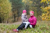 Grandmother With Her Granddaughter In The Autumn Park