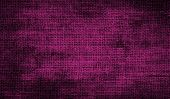 Grunge background of maroon fabric texture