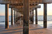 image of vivid  - Coney Island Beach at sunset with a vivid dramatic sky and long shadows - JPG
