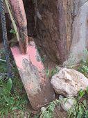 Rustic Shovel and Rock
