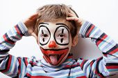 image of clown face  - little cute real boy with facepaint like clown - JPG