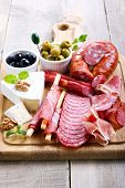 foto of cheese platter  - Catering platter with different meat and cheese - JPG