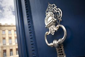 stock photo of bordeaux  - Stylish door knocker on the door of a French mansion in Bordeaux - JPG