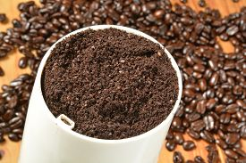 foto of coffee grounds  - Fresh ground coffee in a grinder - JPG