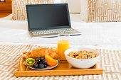 pic of bed breakfast  - Breakfast in bed and a laptop in the room - JPG