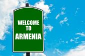 pic of armenia  - Green road sign with greeting message WELCOME TO ARMENIA isolated over clear blue sky background with available copy space - JPG