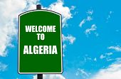 stock photo of algeria  - Green road sign with greeting message WELCOME TO ALGERIA isolated over clear blue sky background with available copy space - JPG