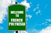 picture of french polynesia  - Green road sign with greeting message Welcome to FRENCH POLYNESIA isolated over clear blue sky background with available copy space - JPG