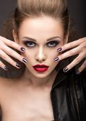 foto of nail-design  - Beautiful girl in leather jacket with bright makeup and manicure Cat - JPG