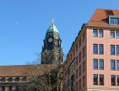 foto of hercules  - Skyline view of old Baroque tower topped by Hercules statue above roof of New Town Hall from alley Kramergasse in afternoon winter sun in Dresden Saxony Germany - JPG