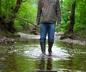 picture of fly rod  - Fisherman with fly - JPG
