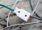 stock photo of electric socket  - Dirty plug socket on the complex electric wire - JPG