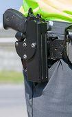 stock photo of policeman  - Policeman with the gun - JPG