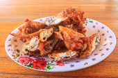 pic of fried chicken  - Fresh fried chicken on a plate set - JPG