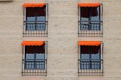 picture of awning  - Facade Of Public Building With Orange Awning - JPG