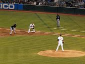 A's Trevor Cahill Stands On Mound With White Sox Manny Ramirez Taking Lead At 1St Base