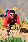 foto of rocking  - rock climber climbs on rock extrim concept - JPG