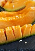 picture of cantaloupe  - Close up Cantaloupe Melon Slices on black board - JPG