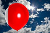 pic of bahrain  - balloon in colors of bahrain balloon flag flying on blue sky  - JPG