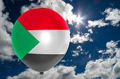 picture of sudan  - balloon in colors of sudan flag flying on blue sky  - JPG