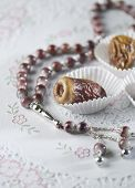 picture of prayer  - Arabic dates arranged in white paper cups with islamic prayer beads - JPG