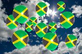 image of jamaican flag  - many ballons in colors of jamaica flag flying on sky - JPG