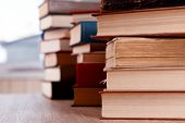 image of hardcover book  - Stacks of books on table close up - JPG
