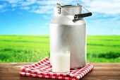 picture of milk  - Retro can for milk and glass of milk on wooden table - JPG