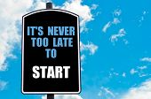 picture of start over  - IT IS NEVER TOO LATE TO START motivational quote written on road sign isolated over clear blue sky background with available copy space - JPG