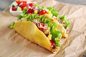 pic of tacos  - Tasty taco with vegetables on paper close up - JPG