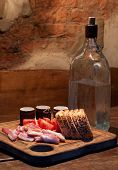 stock photo of vodka  - Russian Vodka and bacon tomato and bread on wooden table - JPG