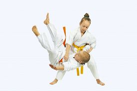 foto of judo  - Sportswoman with a yellow belt is makes throw Judo - JPG
