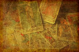 foto of occult  - A textured grunge background image of a group of scattered tarot cards from the major arcana - JPG