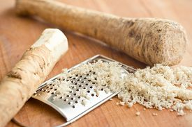 pic of grated radish  - grated horseradish root on kitchen table - JPG