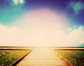 stock photo of opposites  - Wooden path leading to crossroads - JPG