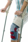 teenager on crutches
