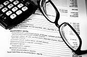 Eye Glasses On An Accounting Book