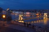 This is a panorama photo of Budapest, the capital of Hungary. It lies on both sides of the river Danube. The old Chain Bridge is one of the most remarkable landmarks of the city.