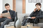 image of anteroom  - Business people sitting on sofa at office anteroom waiting - JPG
